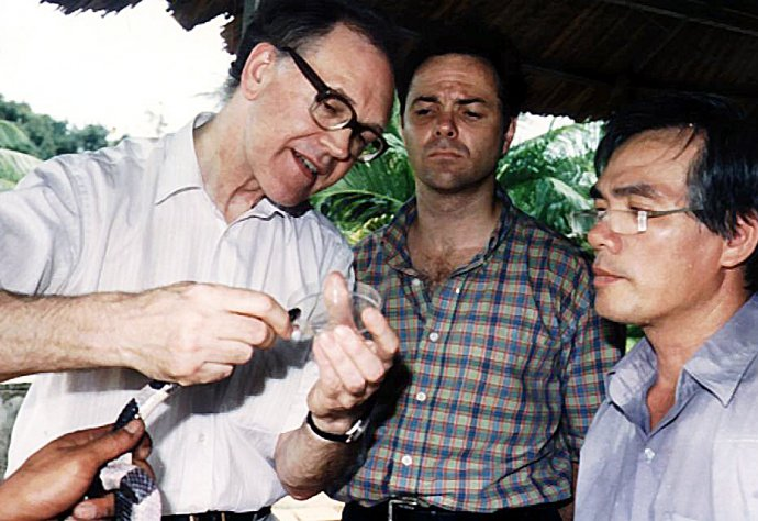 Milking a Malayan krait of its venom with Jeremy Farrar and Trinh Xuan Kiem in Ho Chi Minh City, Vietnam, 1996
