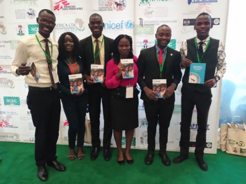 Image of Adebisi with colleagues at the Lassa fever meeting